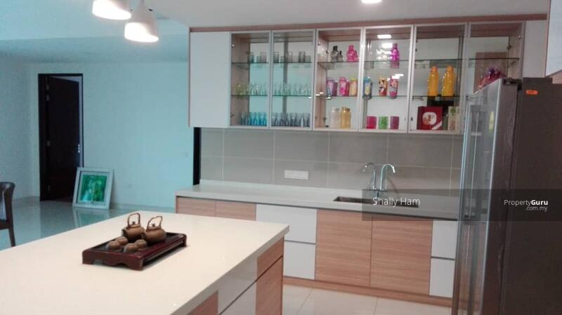 dry kithcen with island and builtin cabinets